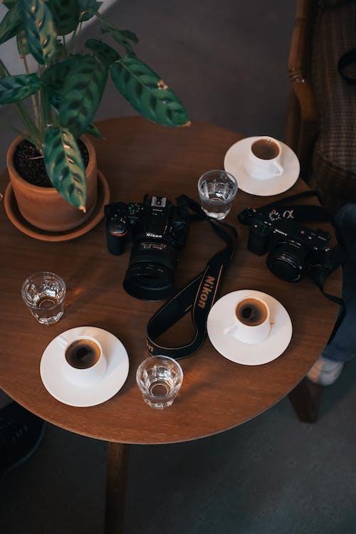 Black Dslr Camera on Table