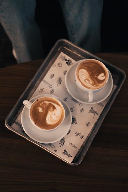 2 White Ceramic Coffee Cups on White Ceramic Tray