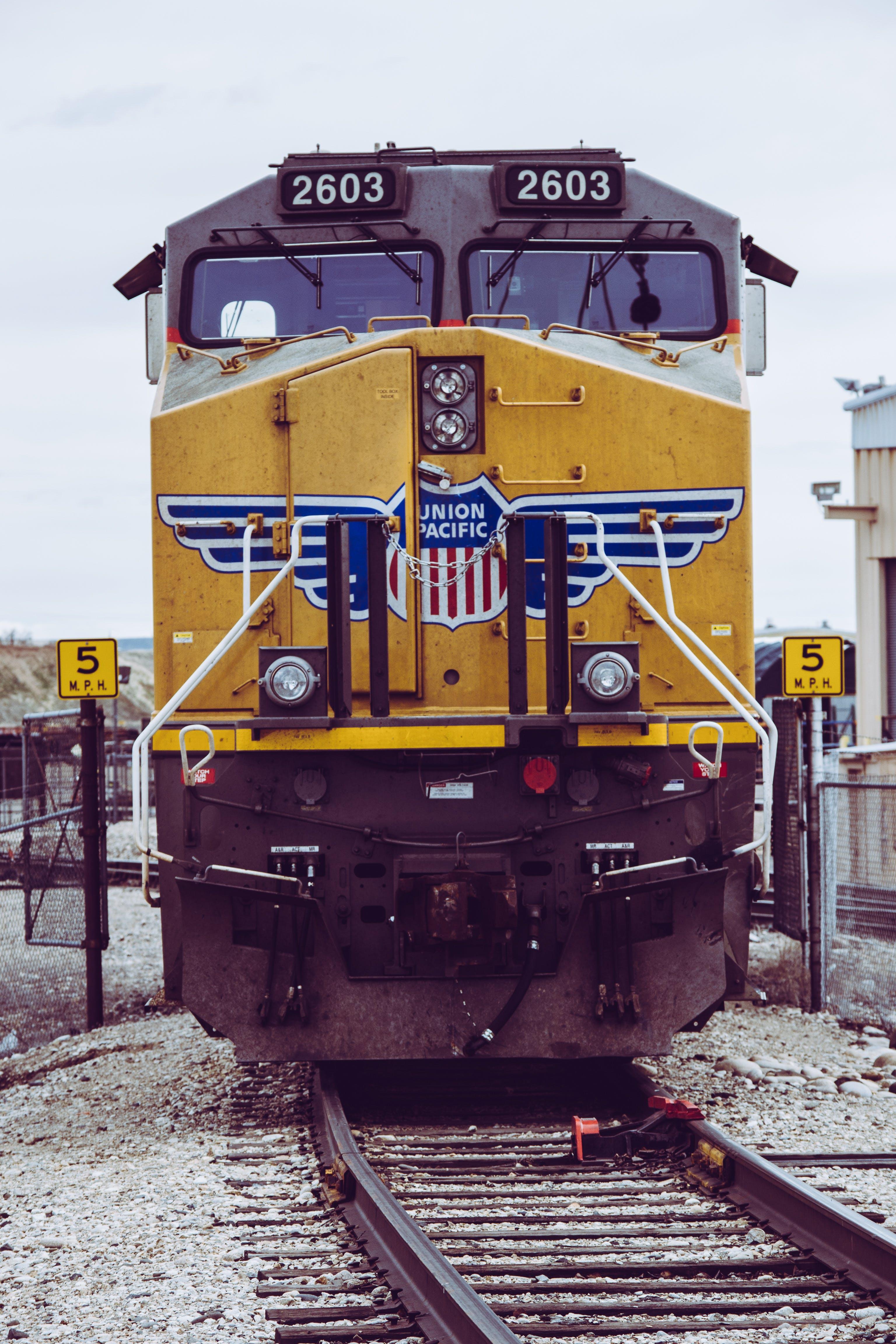 Yellow Train On Railway