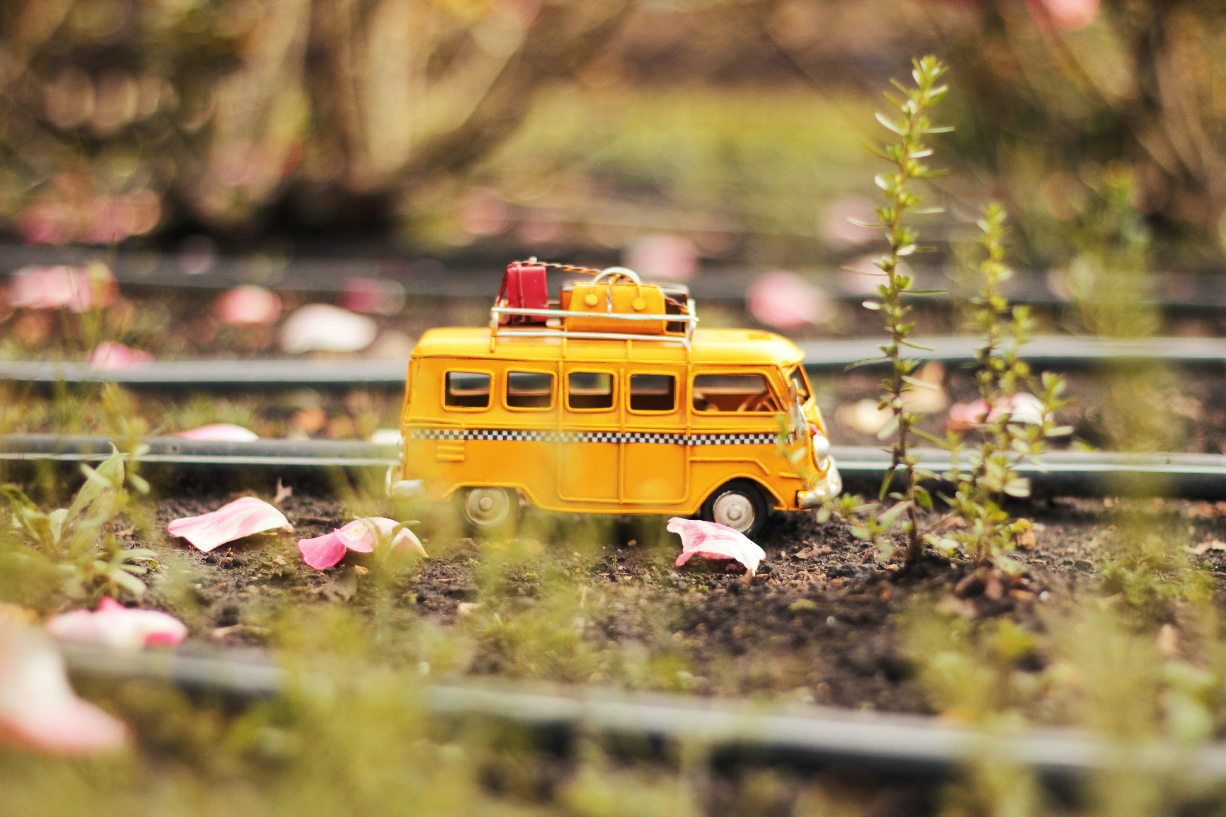 Tilt Shift and Selective Color Photo of White Van Miniature