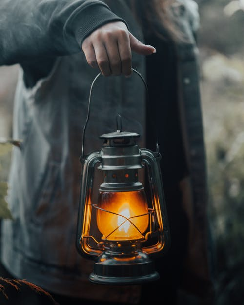 Close up view of woman holding lantern