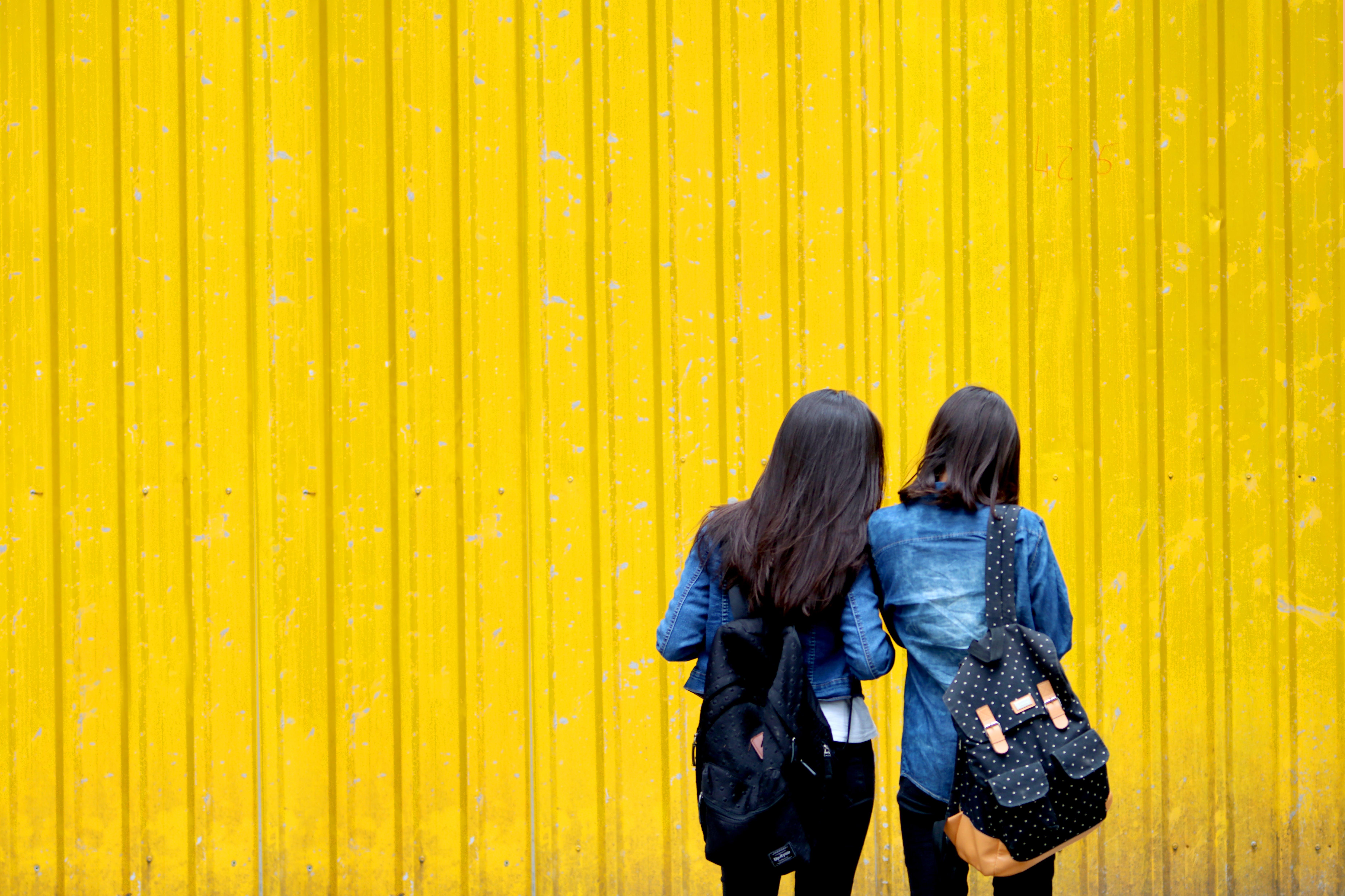 Two Women In Denim Jackets