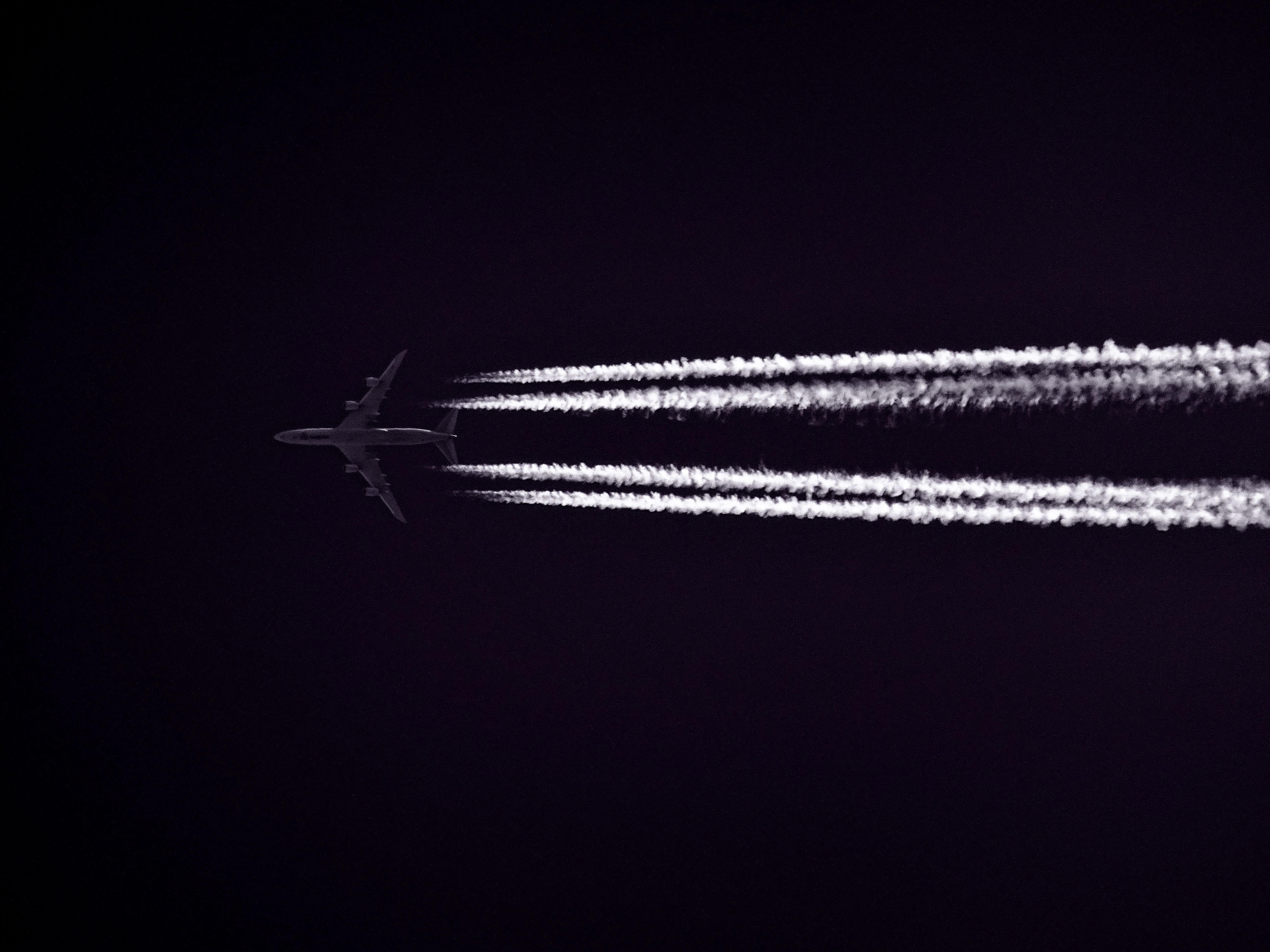 Edit With Snappa Photo Of Airplane Across The Clouds During Night Time
