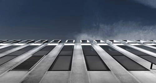 Low Angle of Grey Concrete Building