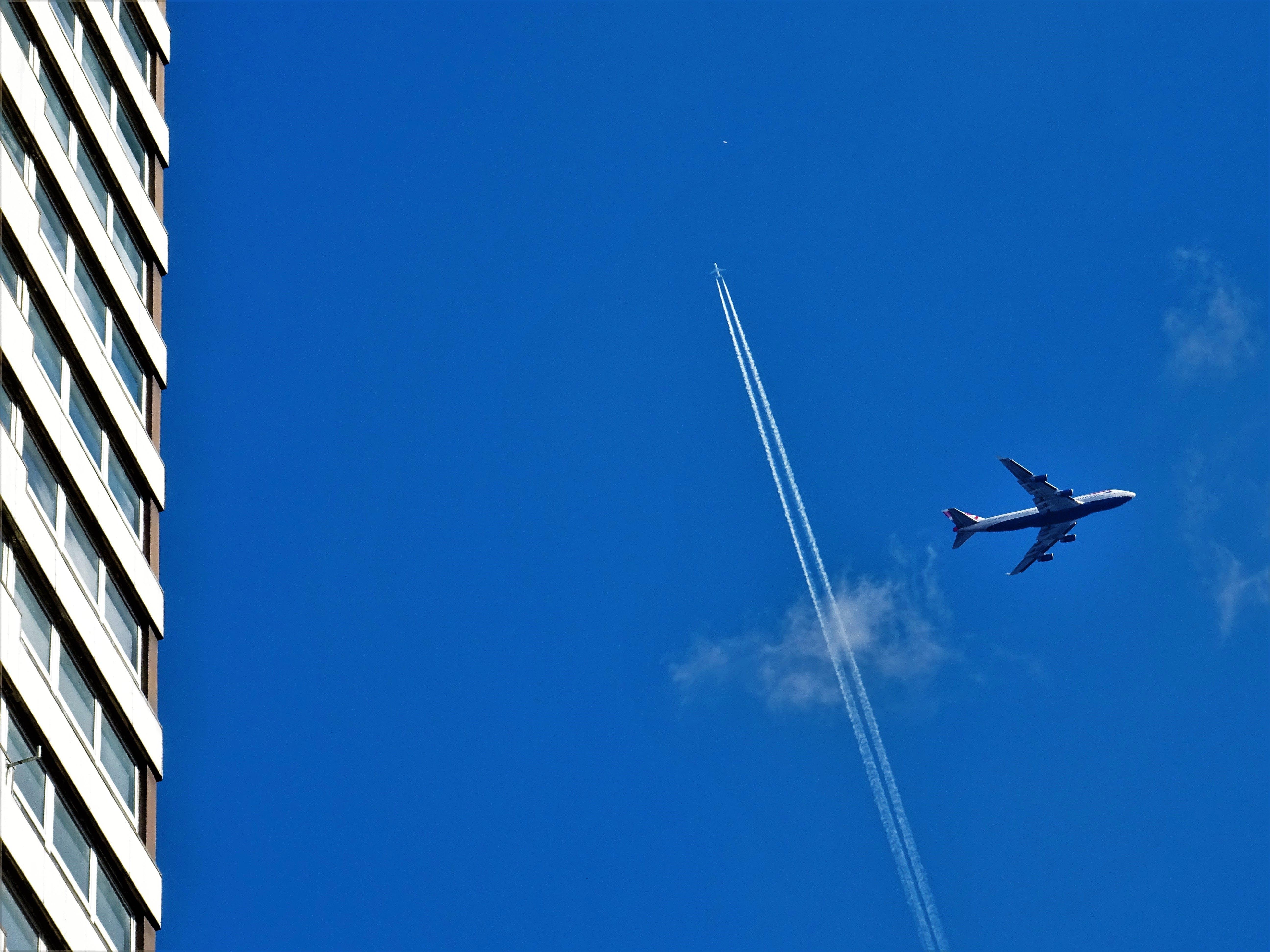 Grey Passenger Plane on Sky at Daytime