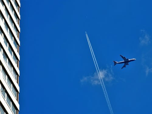 Grey Passenger Plane on Sky at Daytime