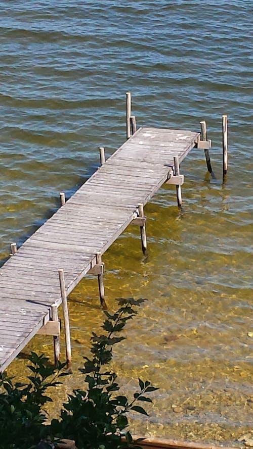 Free stock photo of Lake dock, lake pier, Long walk off short pier, pier