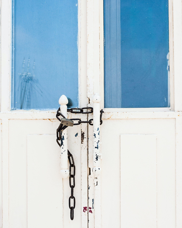 Photo of Locked White Door