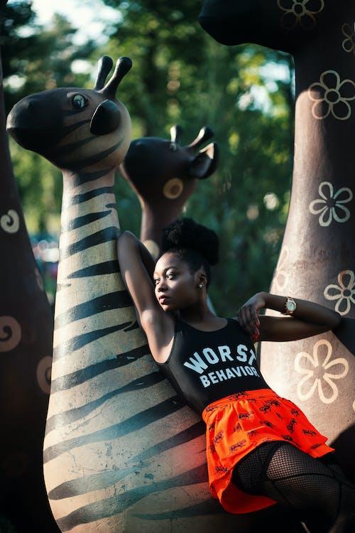 Woman Leaning on Zebra Statue