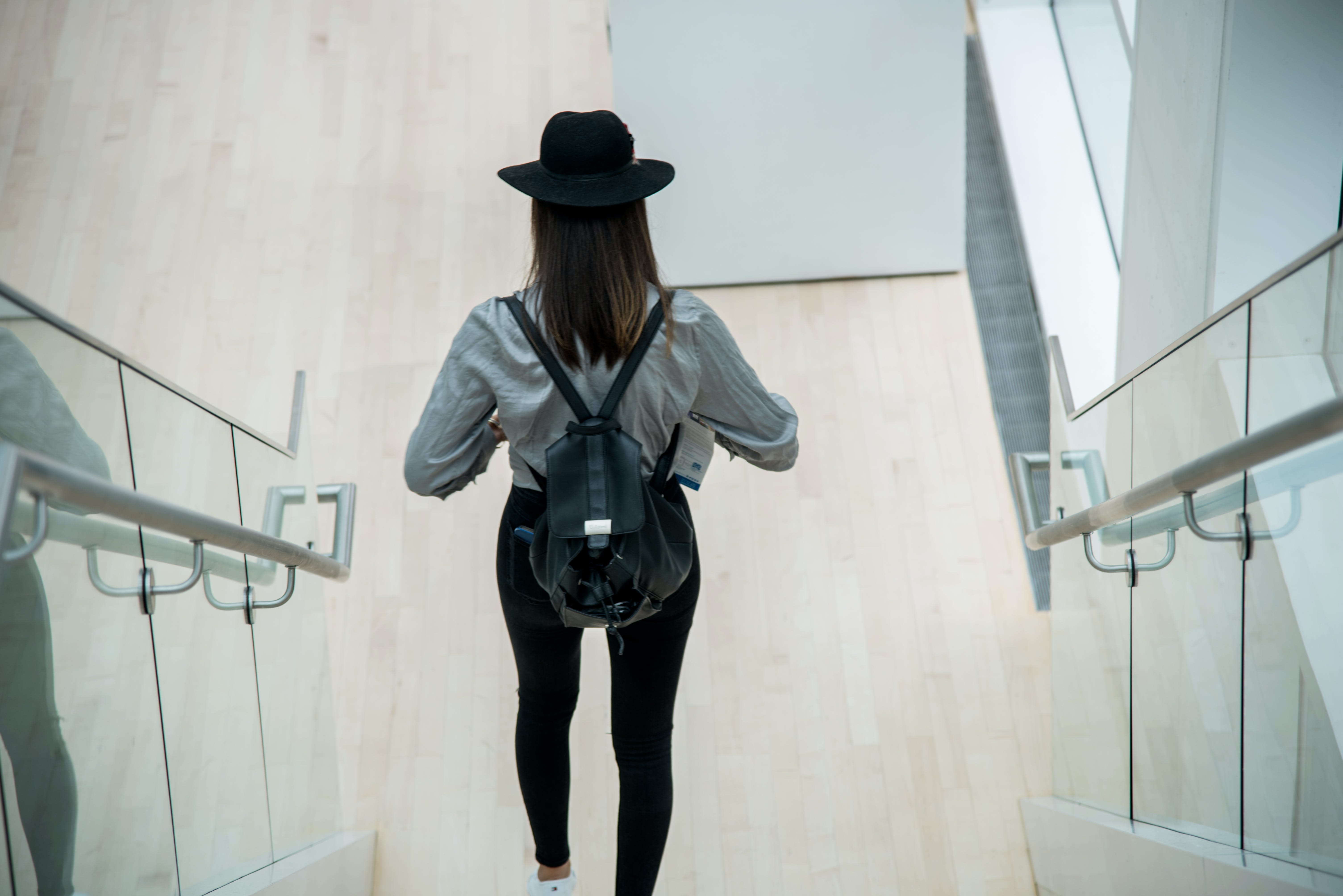 Free stock photo of art museums, black hat, climbing stairs, girl in black hat
