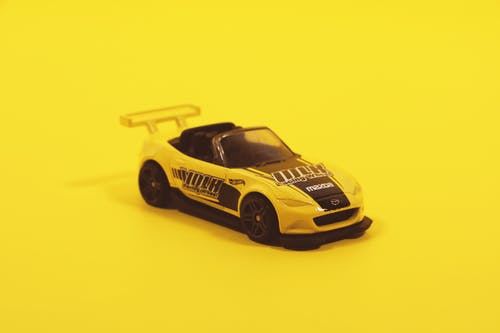 Yellow And Black Toy Car Model