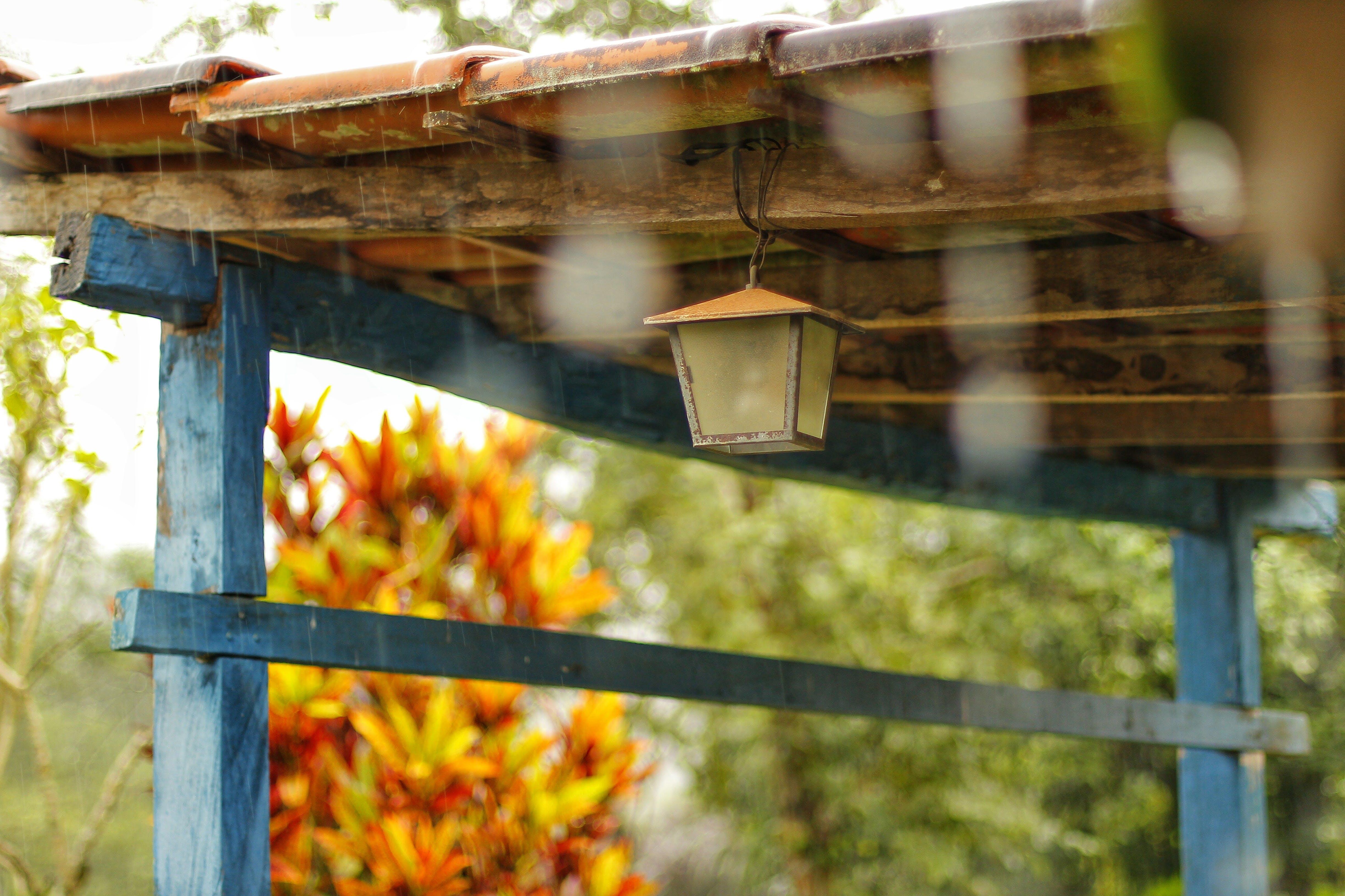 Lantern Hanging On Brown Wooden Ceiling