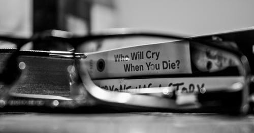 Grayscale Photography View Through Eyeglasses Who Will Cry When You Die? Labeled Book