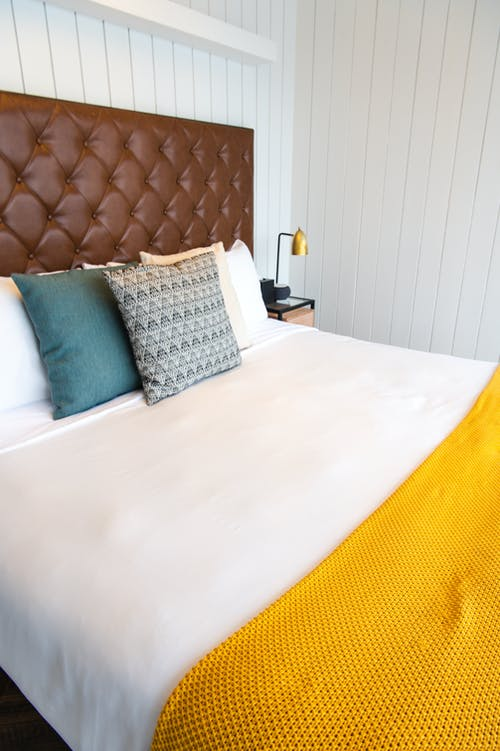 White Bed With Blue Pillow