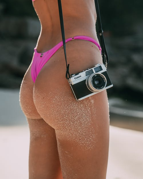 Black and Silver Point and Shoot Camera on Persons Lap