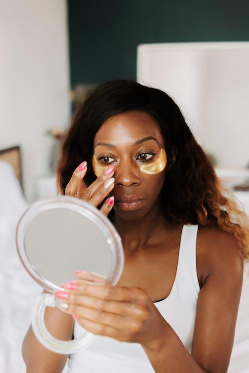 Kostnadsfri bild av ansiktsmask, ansiktsvård, applicering