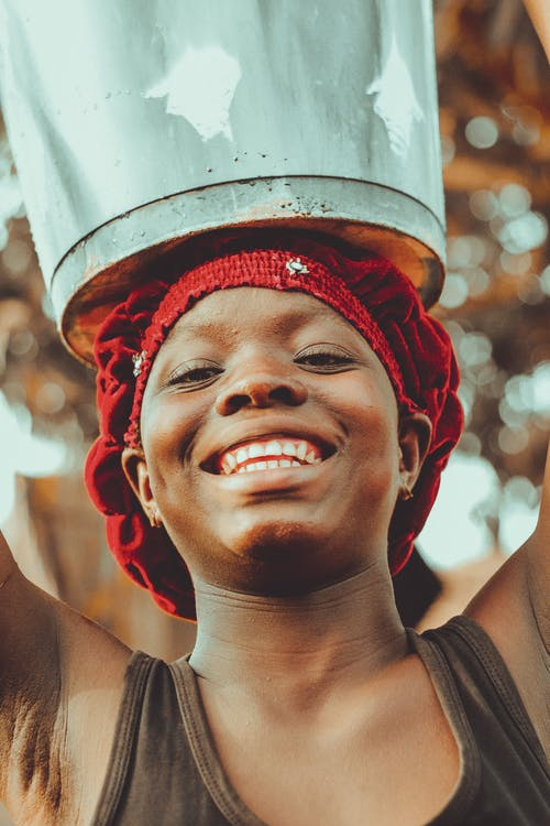 African Woman Holding Bucket on Head