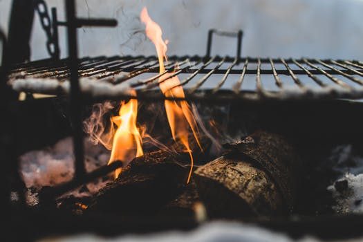 Burning Under Black Metal Grill