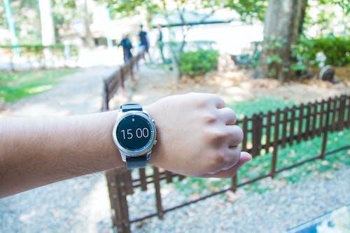 Round Black Smartwatch worn on the wrist