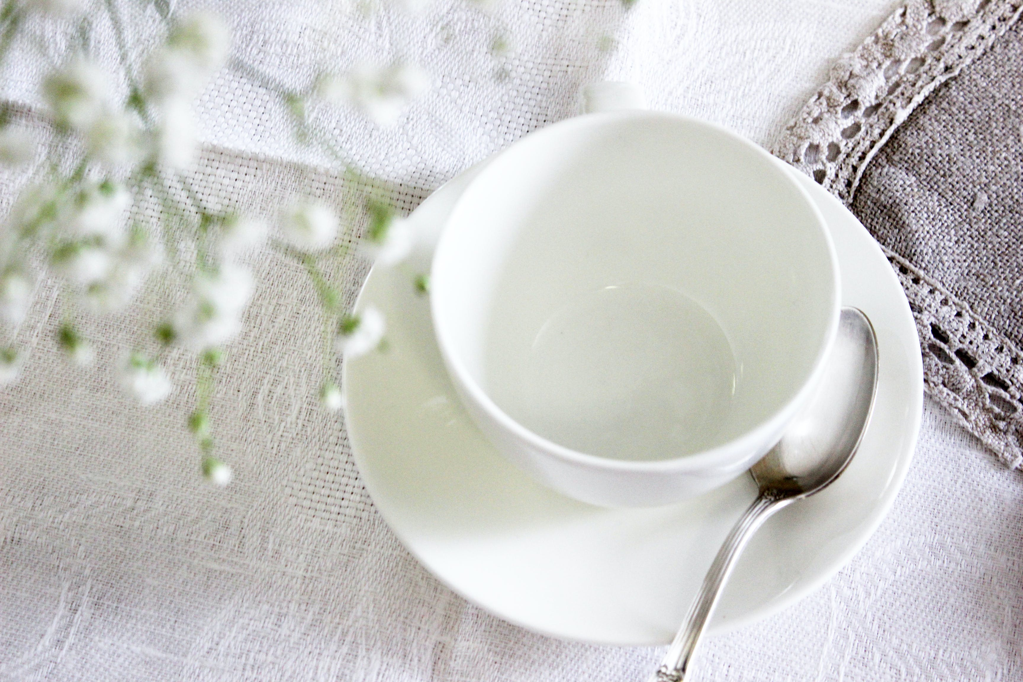White Ceramic Tea Cup With Saucer and Spoon
