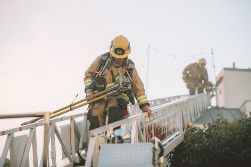 Firefighters on ladder