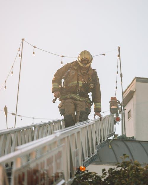 Firefighter climbing down the ladder