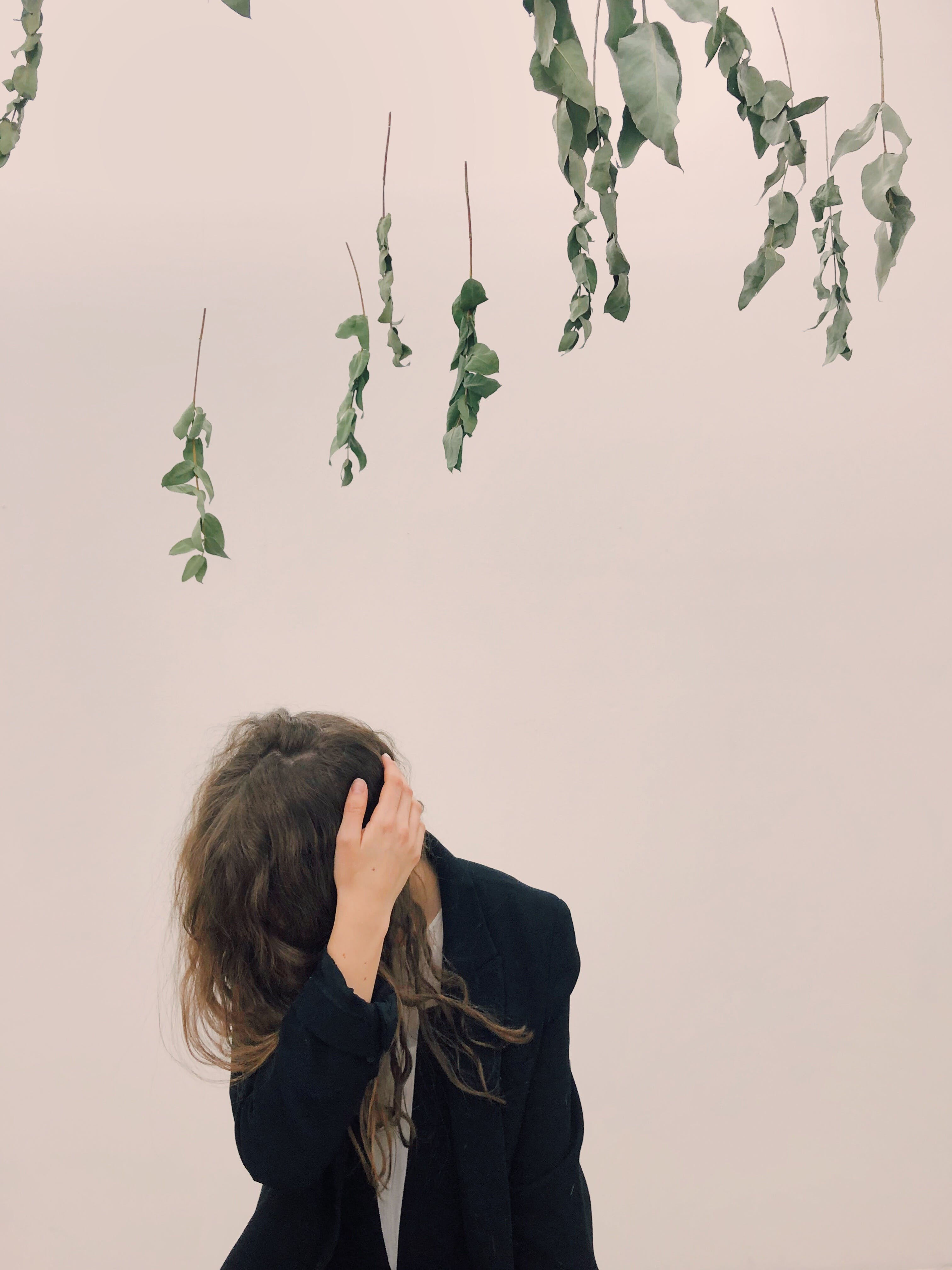 Woman Wearing Black Blazer Beside White Wall
