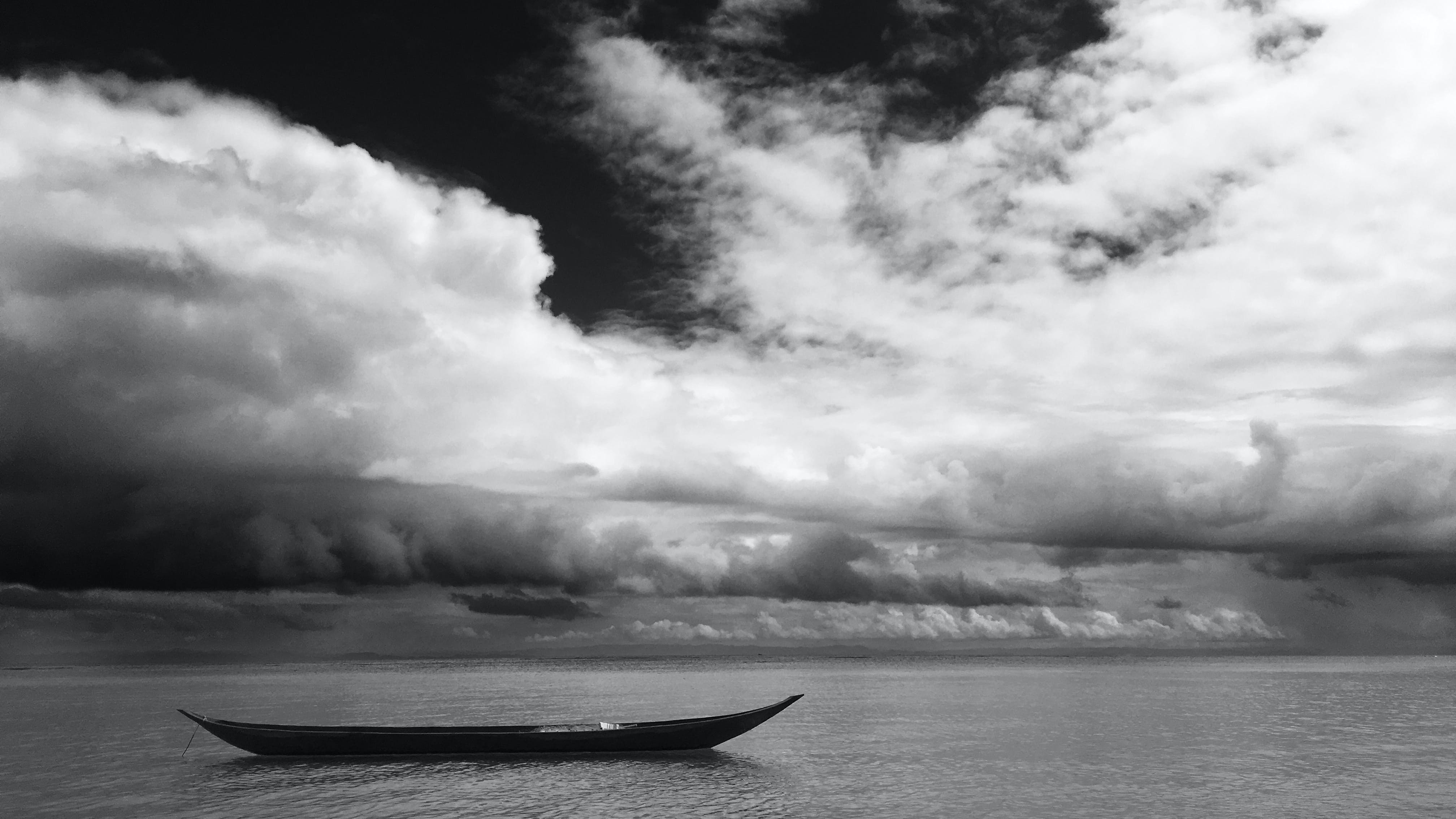 Grayscale Photo of Black Boat
