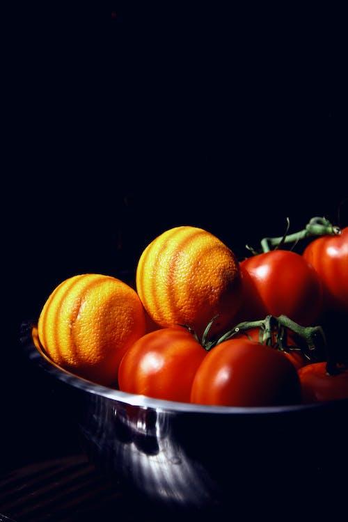 Orange Fruits on Blue Ceramic Bowl