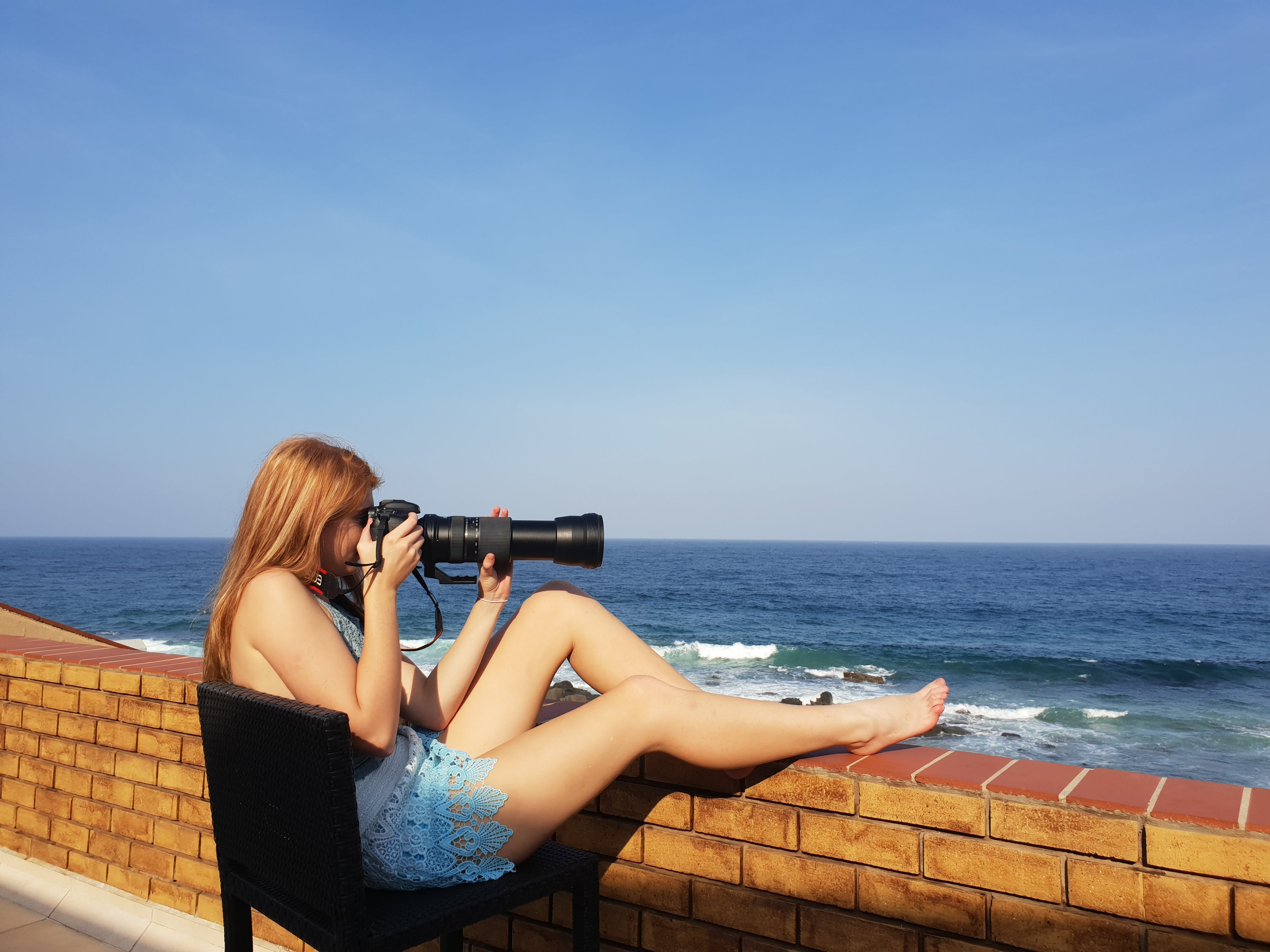 Woman Sitting Holding Dslr Camera