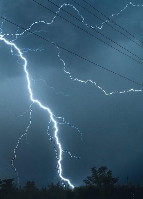 Lightning crossing night sky