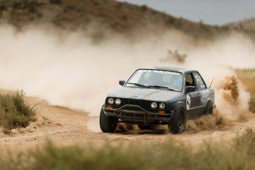 Rally Car and Dust