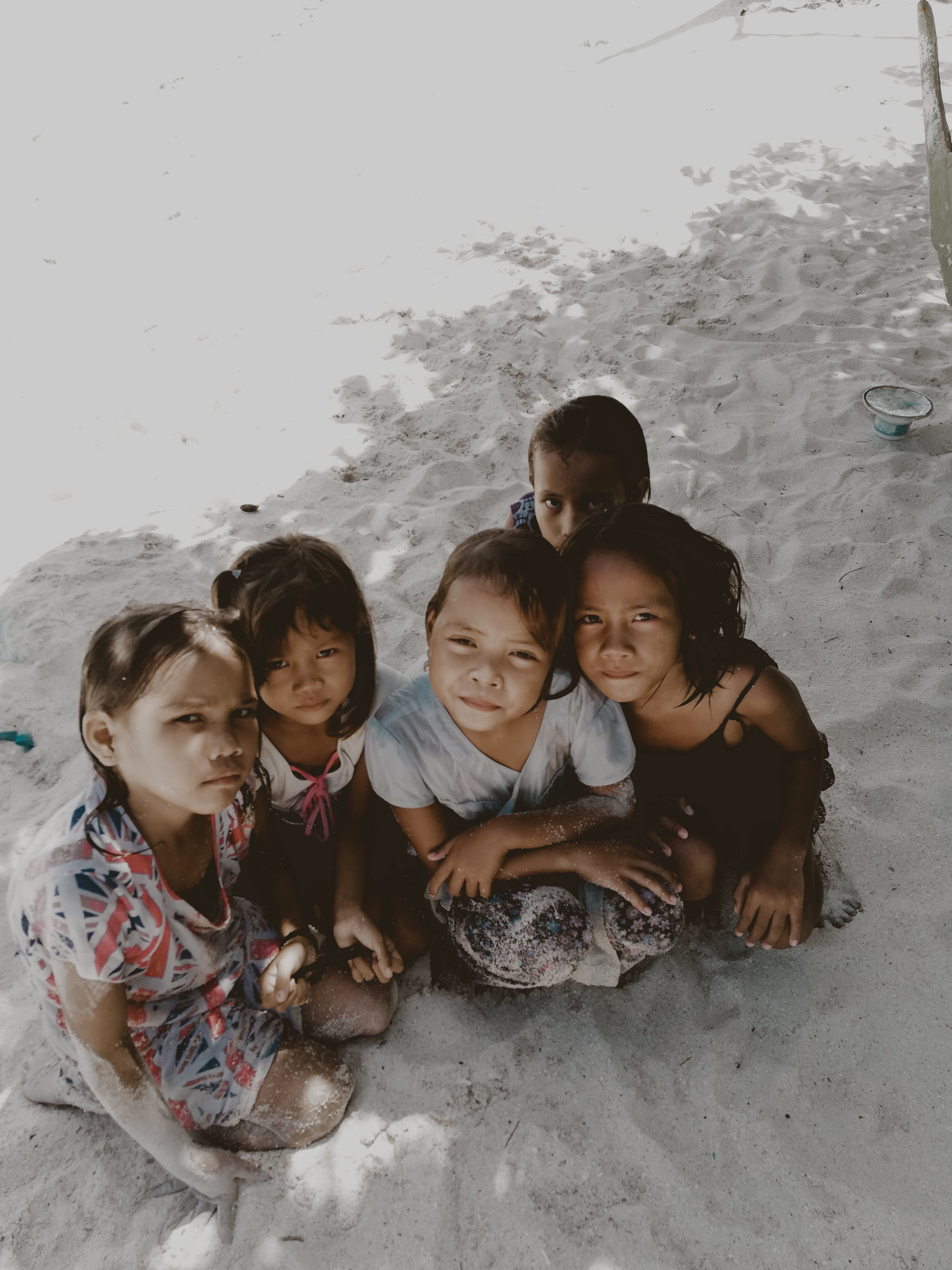 Five Toddlers Sitting on Sand