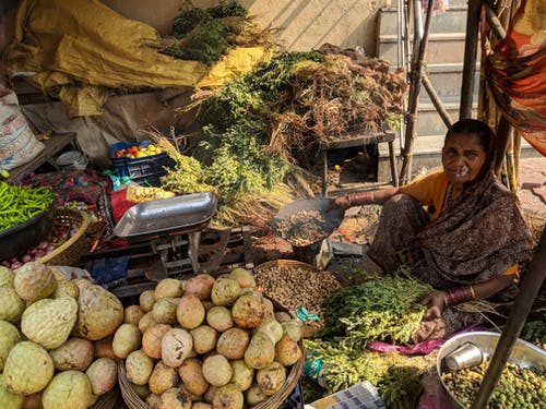 Woman Beside Vegetables On Baskets