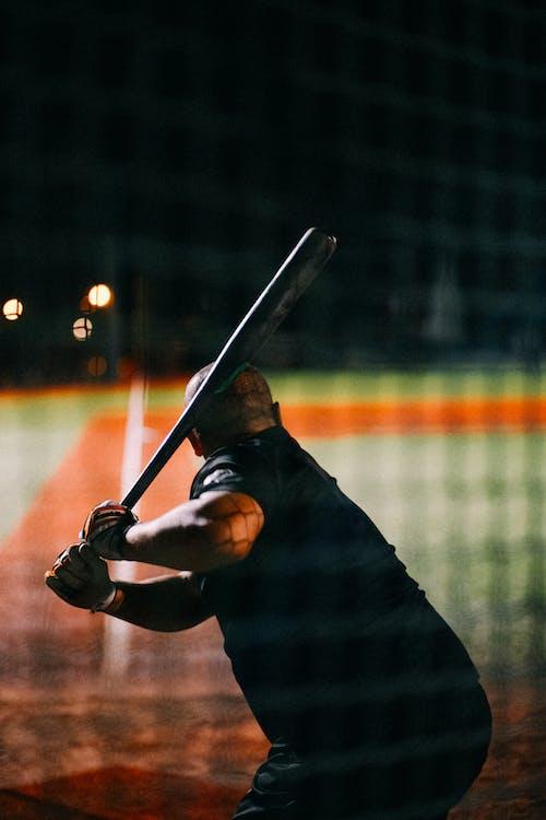 Man in Black Jacket Holding Baseball Bat