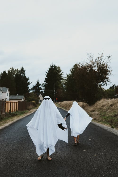 People In White Bedsheet Dressed as Ghosts