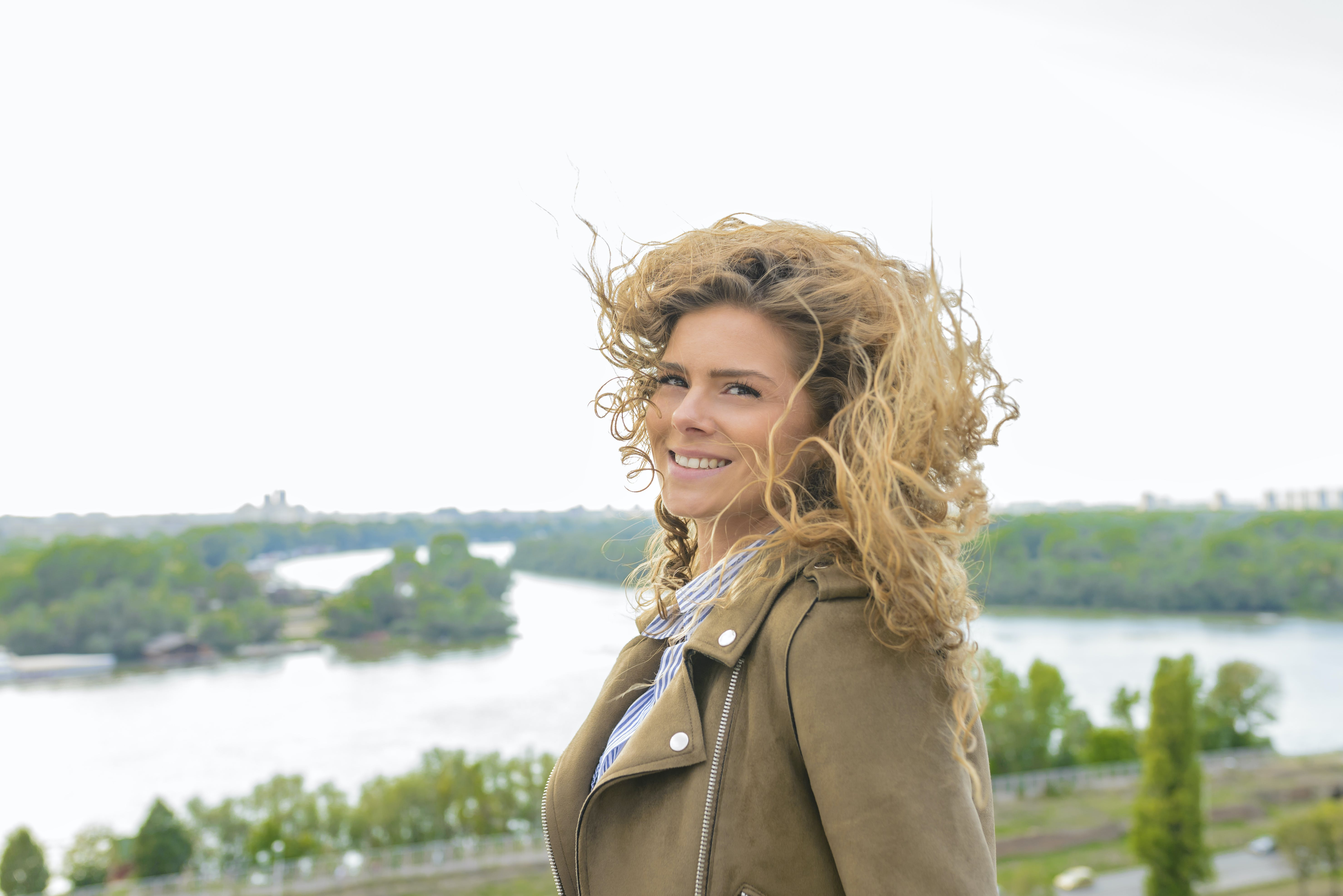 Woman Wearing Brown Coat Smiling