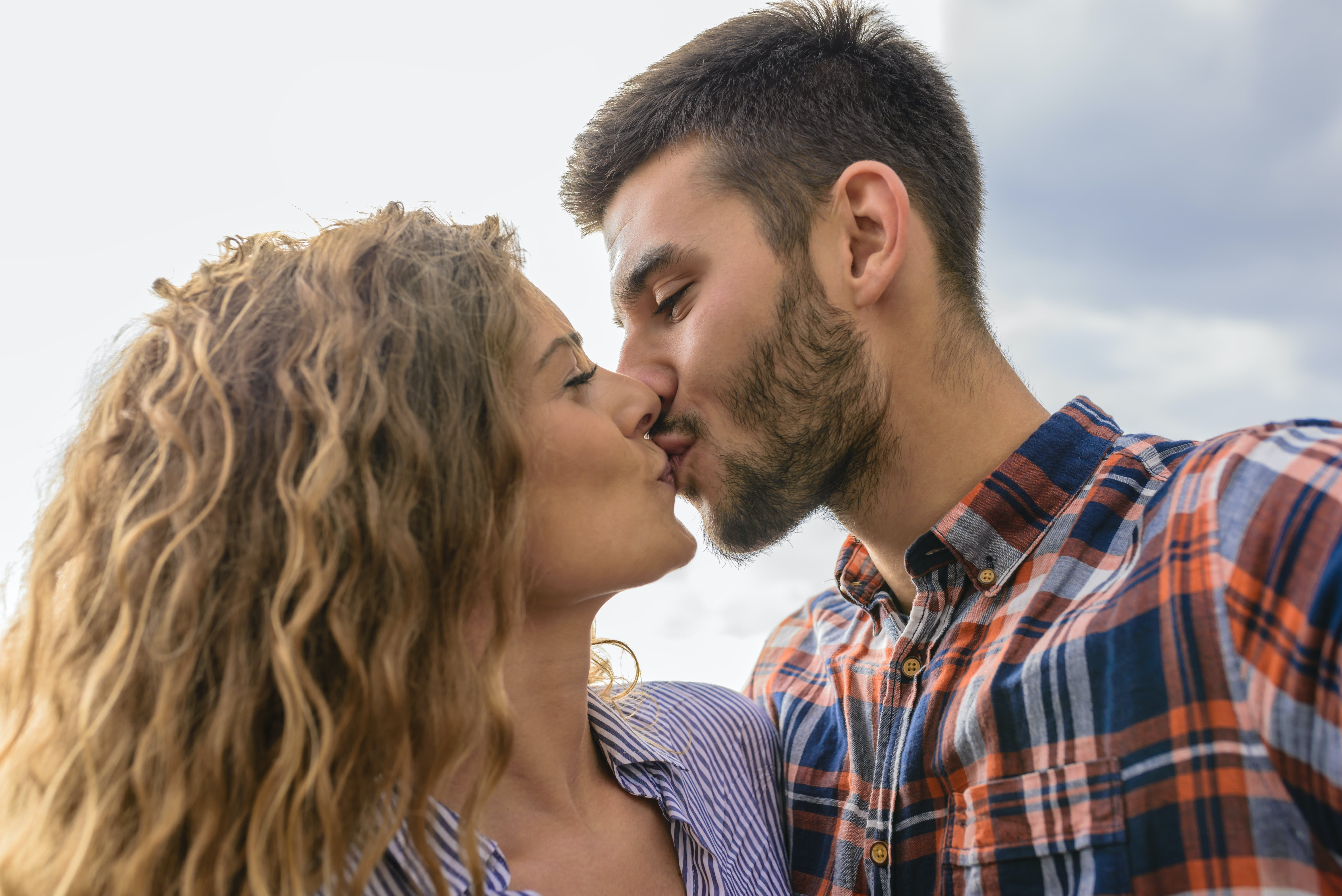 Woman And Man Kissing Each Other