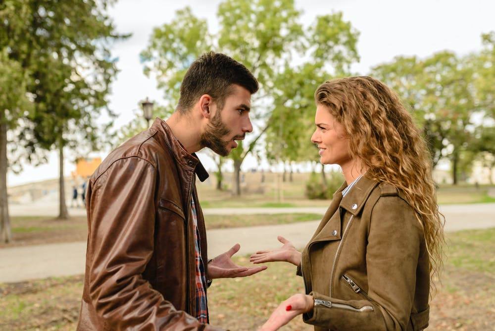 Angry couple arguing in the park. | Photo: Pexels