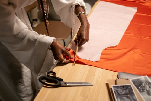 Close-upVew of Fashion Designer Cutting Fabrics