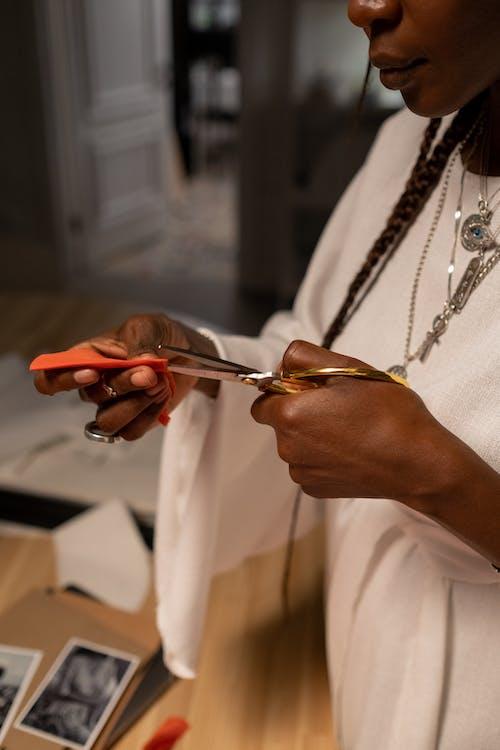 Close-up view of Fashion Designer Holding Scissors