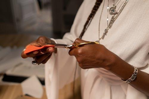 Close-upView of Fashion Designer Cutting Fabrics