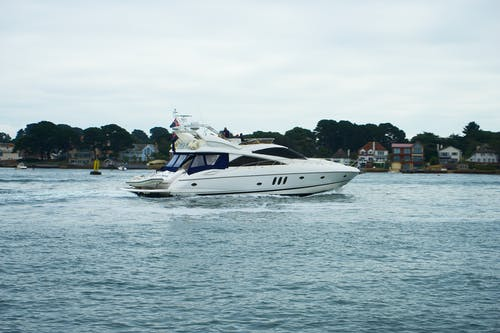 White and Black Motor Boat on Sea