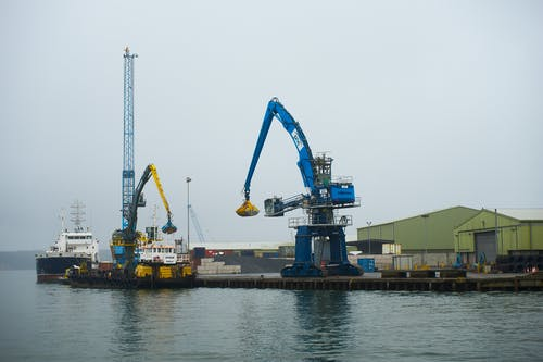 Blue and Yellow Crane on Dock
