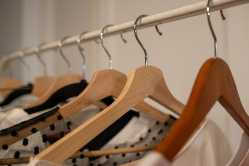 A close up on Hangers with Clothes