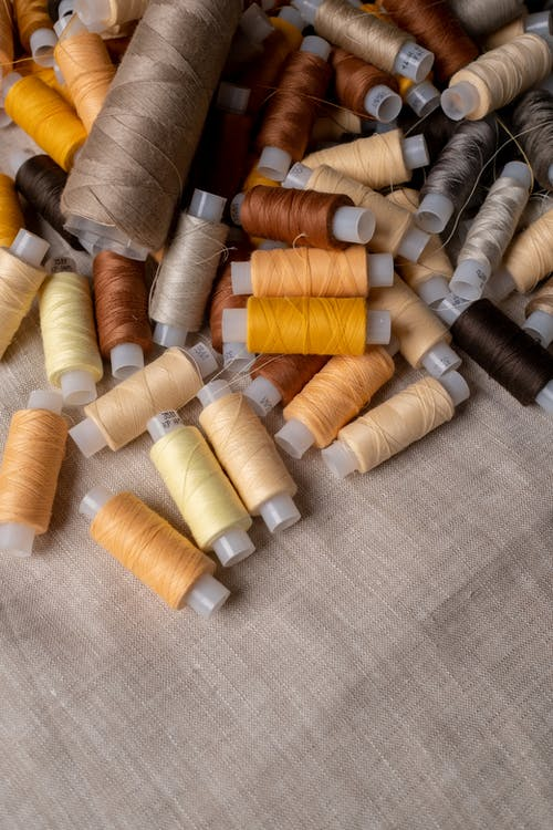 A High Angle Shot of Sewing Threads