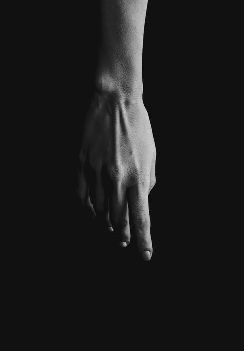 A Black and White Photo of a Hand