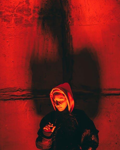 Woman in Black Hoodie and Purple Hijab