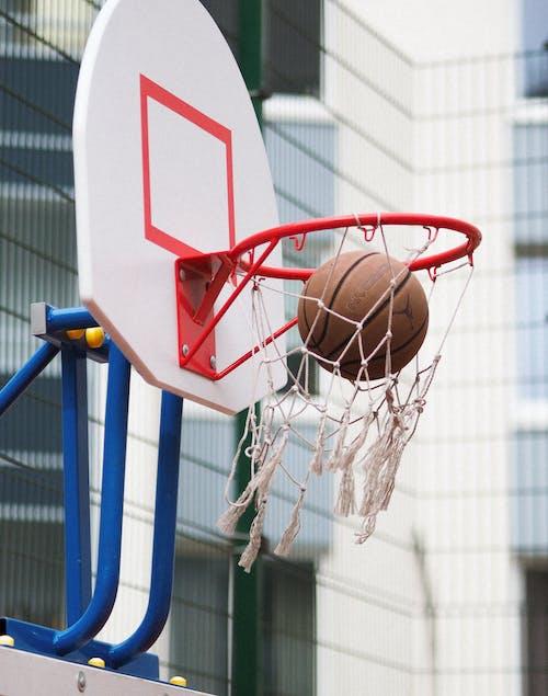 Ball Inside Basketball Hoop