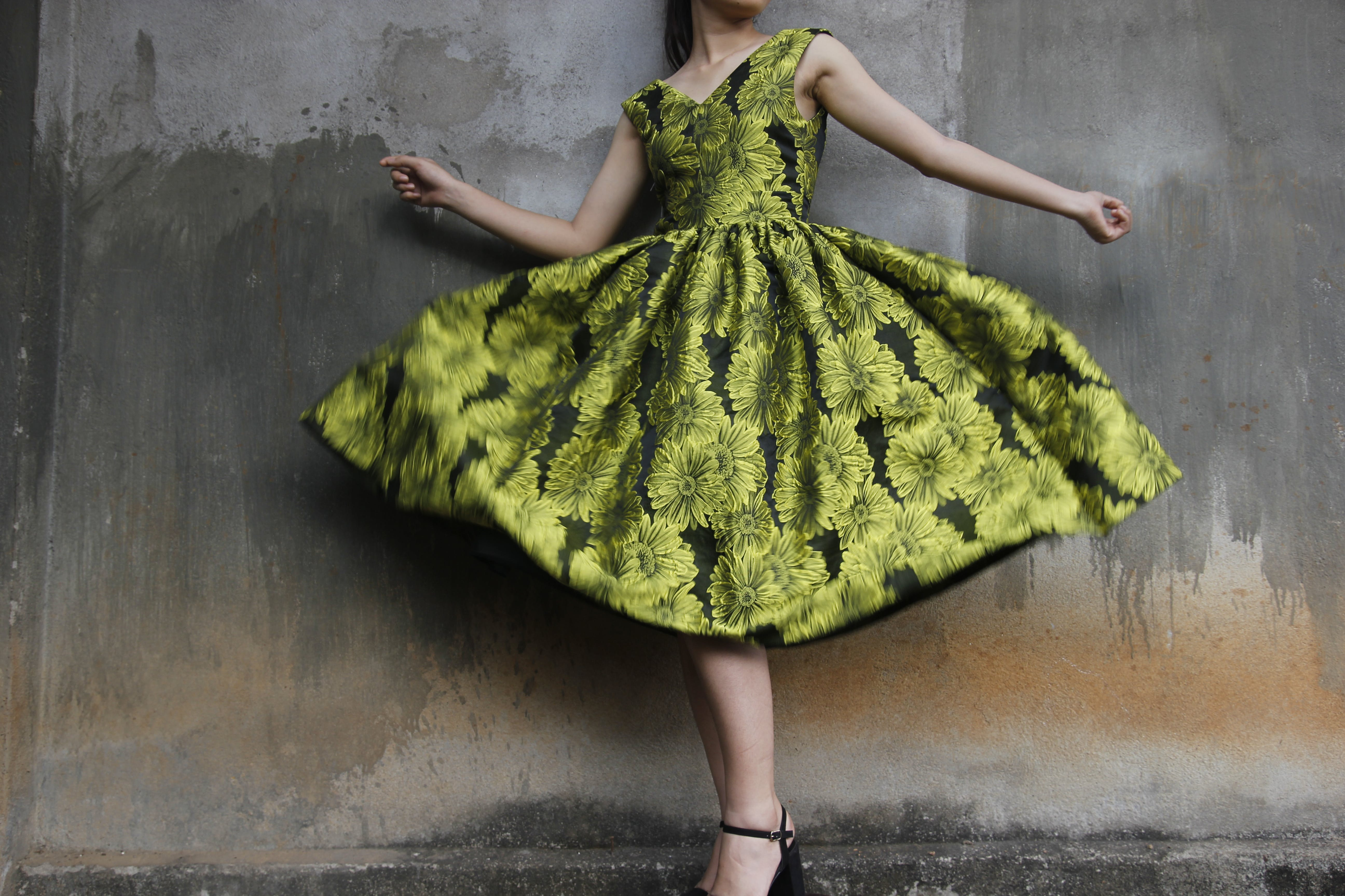 Photo of a Woman Wearing Green Dress
